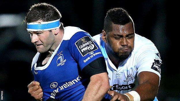 Leinster's Fergus McFadden is tackled by Taqele Naiyaravoro of Glasgow