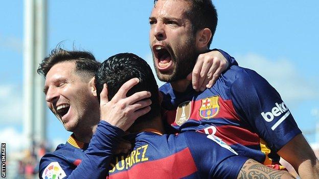 Barcelona players celebrate a Luis Suarez goal against Granada