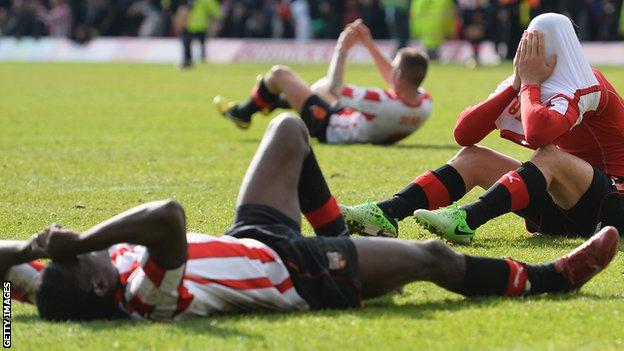 Brentford players sit dejected