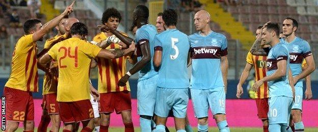 Birkirkara and West Ham players tussle during the match