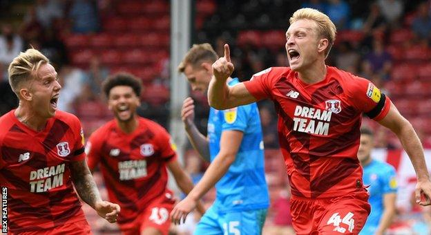 Josh Wright (right) celebrates scoring the goal which gave Orient an opening-day win over Cheltenham