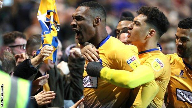 Krystian Pearce celebrates scoring for Mansfield