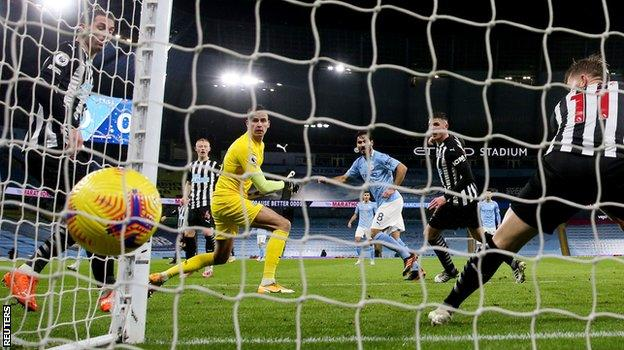 Ilkay Gundogan scores for Manchester City against Newcastle