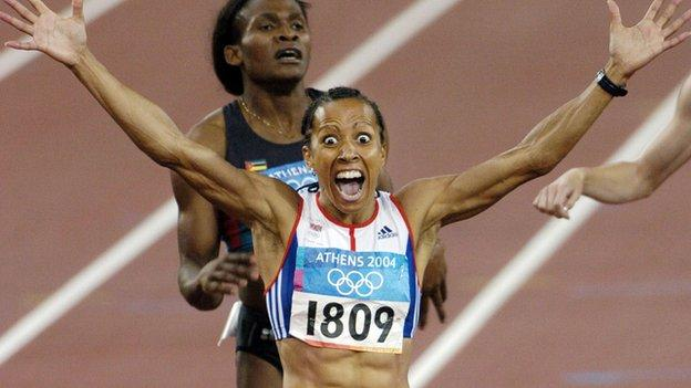 Dame Kelly Holmes crosses the finishing line to win the 800m at the 2004 Olympic Games