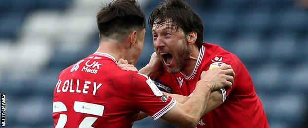 Nottingham Forest players Joe Lolley and Harry Arter celebrate a goal against Blackburn