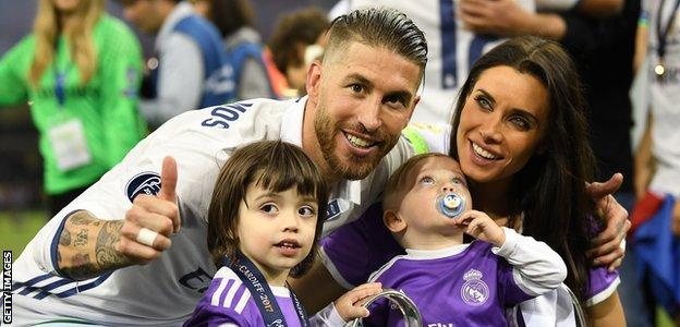 Sergio Ramos with his wife - Spanish TV star Pilar Rubio - and two of his children after the 2017 Champions League final