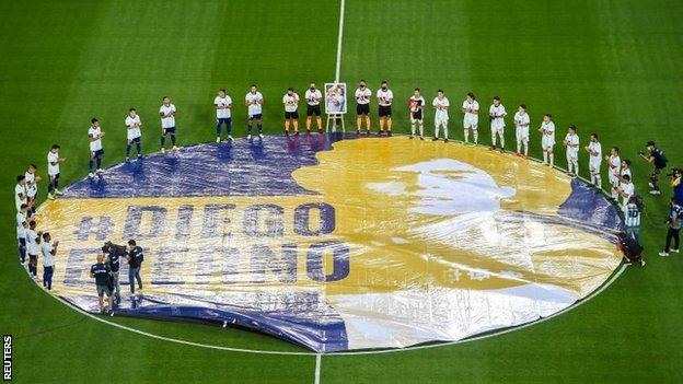 Players stood around a large Maradona flag before kick-off for a minute's applause
