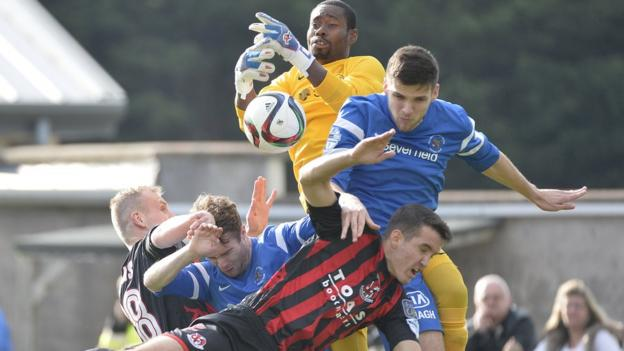 Ballinamallard United keeper Alvin Rouse rises highest to claim the ball as Crusaders threaten at Ferney Park