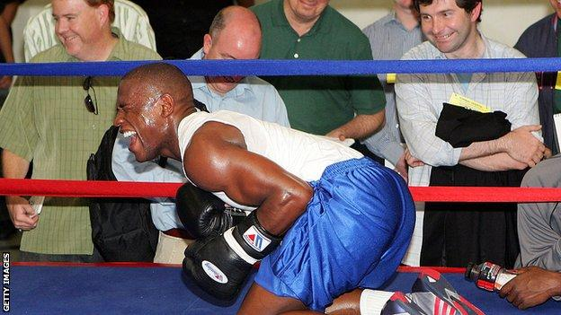 Mayweather entertained reporters by impersonating his opponent struggling after taking a body shot