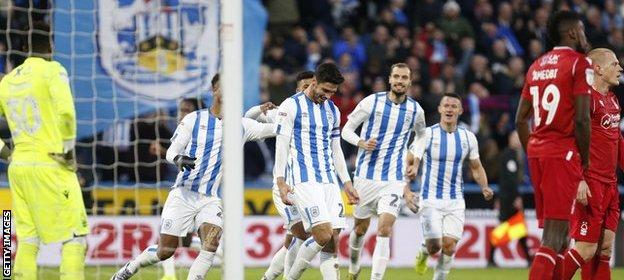 Huddersfield Town players celebrate Christopher Schindler's first-half goal