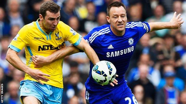 Chelsea's John Terry tussles with James McArthur of Crystal Palace