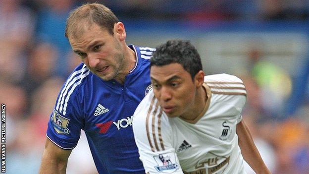 Chelsea defender Branislav Ivanovic (left) chases Swansea's Jefferson Montero