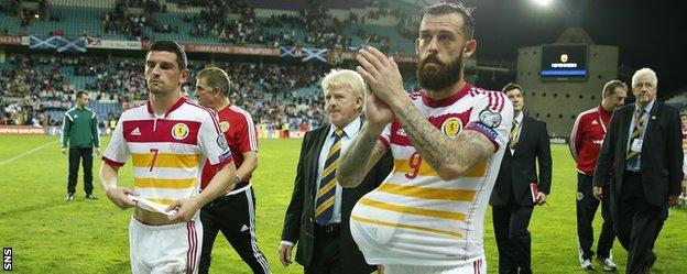 Scotland's Steven Fletcher steals the match ball after his hat-trick against Gibraltar