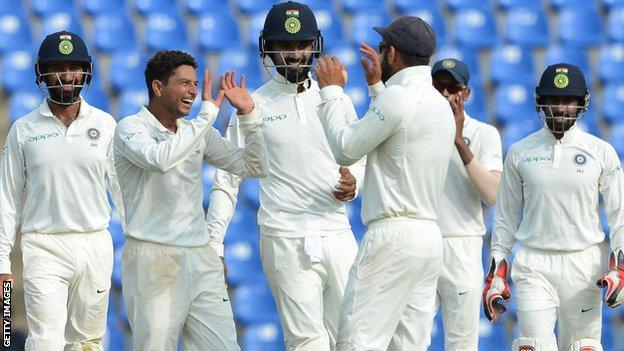 India players celebrate a wicket