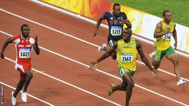 Usain Bolt (centre) wins the 100m at the 2008 Beijing Olympics