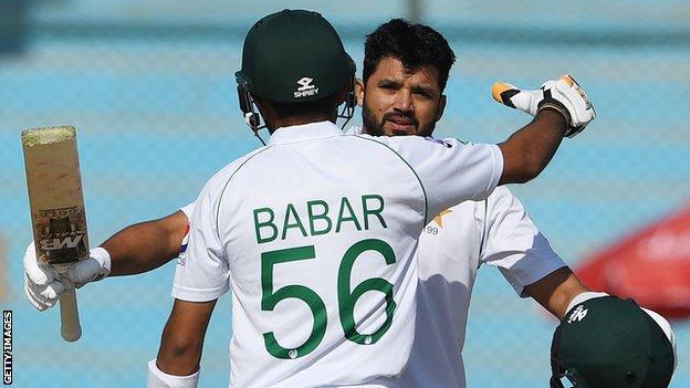 Pakistan captain Azhari Ali (right) hugs Babar Azam (left) after hitting a century in the second Test against Sri Lanka