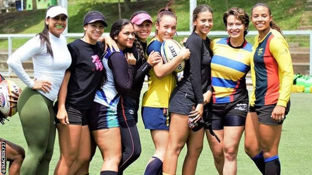 Isabel Romero and her team-mates pose for a photo