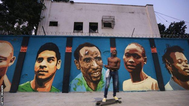 a new mural of street art honoring the first Olympic refugee team during the Rio 2016 Olympic Games on August 17, 2016 in Rio de Janeiro, Brazil. The graffitti, created by the artists Rodrigo Sini and Cety Soledade, honors the stateless refugees, six men and four women, who hail from South Sudan, Syria, the Deomocratic Republic of Congo and Ethiopia.