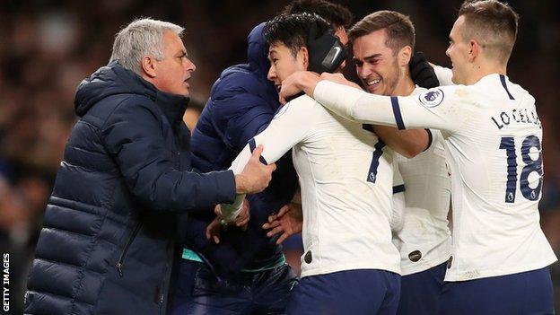 Jose Mourinho celebrates with his Tottenham players