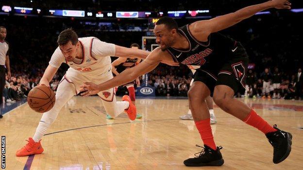 Mario Hezonja tries to go past Jabari Parker of the Chicago Bulls