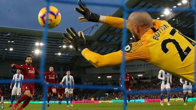 Salah lifted his penalty over the dive of David Button