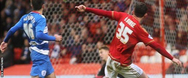 Nottingham Forest's Oliver Burke (right) shoots at goal against QPR