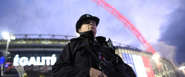 An armed police officer outside Wembley