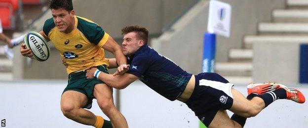 Scotland wing Ben Robbins tackles Australia's Simon Kennewell