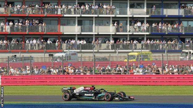 Fans watch Lewis Hamilton at the British Grand Prix