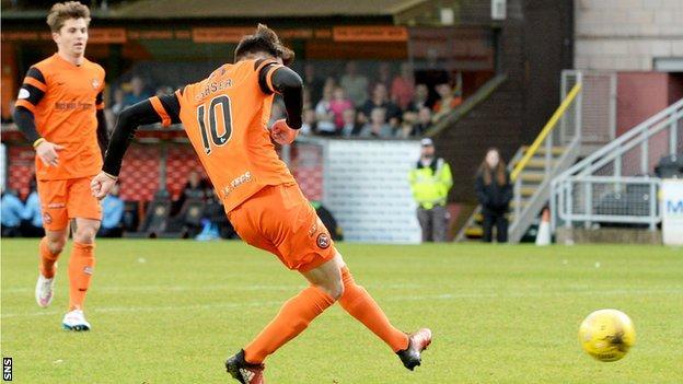 Scott Fraser slots home the equaliser for Dundee United