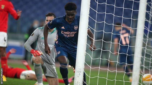 Bukayo Saka celebrates scoring for Arsenal against Benfica
