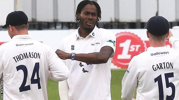 Jofra Archer celebrates taking the wicket of Kent opening batsman Jordan Cox