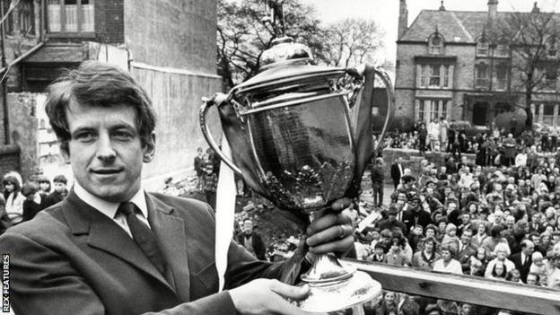 Skelmersdale United player John Turner shows off the FA Amateur Cup to crowds who welcomed the team home after their 1971 Wembley triumph