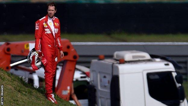 Sebastian Vettel stands alone after colliding with team-mate Charles Leclerc
