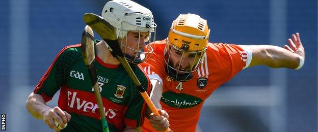 Armagh's Conor Devlin challenges Mayo's Shane Boland