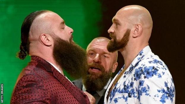 Braun Strowman squaring up to Tyson Fury