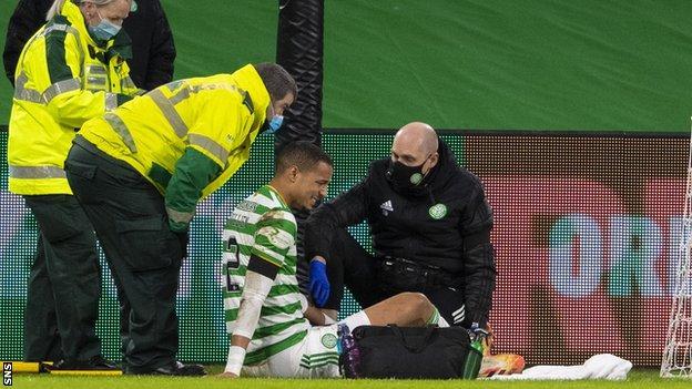 Celtic defender Christopher Jullien receives treatment on an injury
