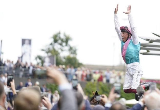 Frankie Dettori performs a trademark flying dismount as punters cheer at Ascot
