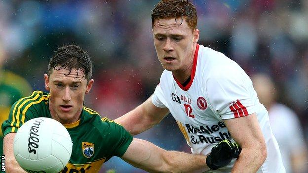 Jonathan Lyne of Kerry competes against Tyrone's Conor Meyler at Croke Park