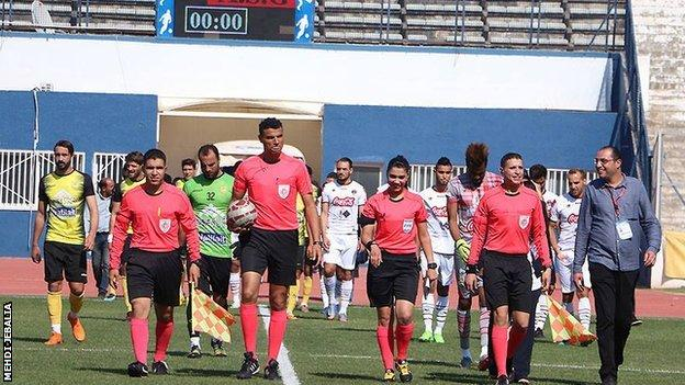 Dorsaf Ganouati (second right) walks out with her fellow officials at a Tunisian Ligue 1 match