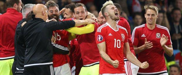 Aaron Ramsey and Wales team-mates celebrate after win over Belgium