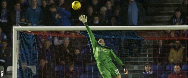 Owain Fon Williams makes a save in the Highland derby