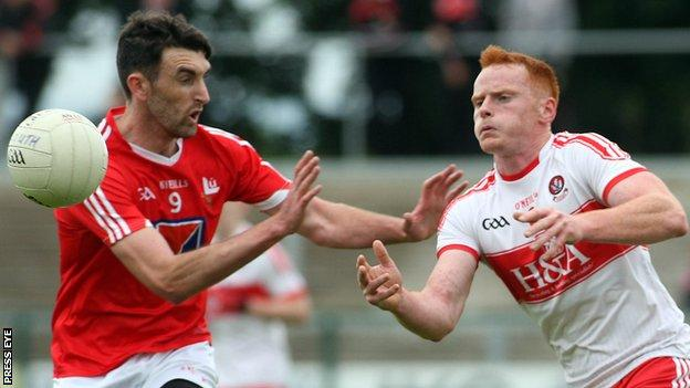 Louth's James Califf battles with Derry's Conor McAtamney at Owenbeg