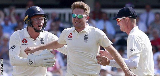 Liam Dawson celebrates a wicket with Jonny Bairstow and Keaton Jennings