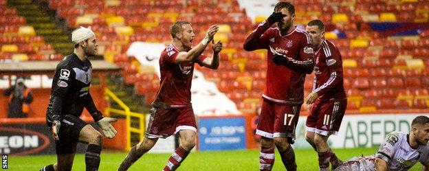 Aberdeen's Adam Rooney claims for a late penalty