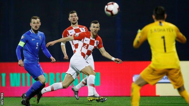 Croatia's Ivan Perisic (centre) in action