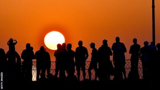 Fans watch the sun go down