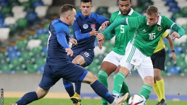 Daniel Ballard in a tussle for the ball with Northern Ireland U21s