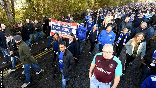Fans march towards the King Power Stadium in honour of Vichai Srivaddhanaprabha