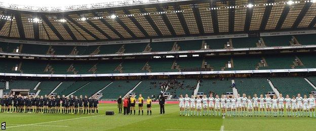 Women's Varsity match teams line-up for National Anthem